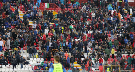 slicker: VICENZA, ITALY - October 13, 2015: UEFA Under-21 Championship Qualifying Round, football match between Italy and Republic of Ireland. Spectators in the stands of the Romeo Menti Stadium.