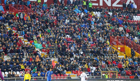 romeo: VICENZA, ITALY - October 13, 2015: UEFA Under-21 Championship Qualifying Round, football match between Italy and Republic of Ireland. Spectators in the stands of the Romeo Menti Stadium.