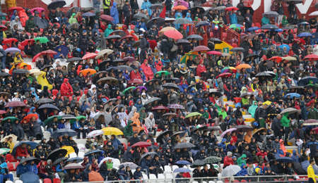 impermeable: VICENZA, ITALY - October 13, 2015: UEFA Under-21 Championship Qualifying Round, football match between Italy and Republic of Ireland. Spectators in the stands of the Romeo Menti Stadium.