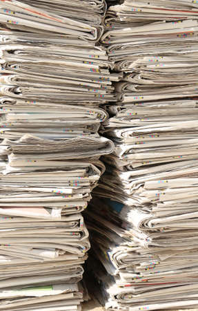 pile of newspapers: huge pile of many newspapers recyclable waste collection centre
