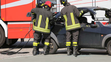 freed: Firefighters freed the wounded man inside the car after car crash with the wrecked car