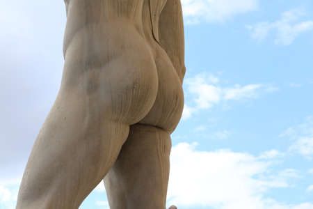 backside: back of the marble statue with white buttocks Stock Photo