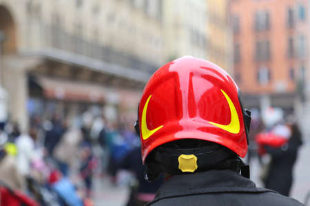 watch city: Watch fireman with red Hardhat controls the people of the city during the protest March
