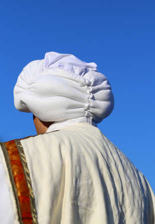 middle eastern clothes: Arab man with white turban and blue sky Stock Photo