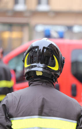 supervise: brave firefighters with red Hardhat checks in the city