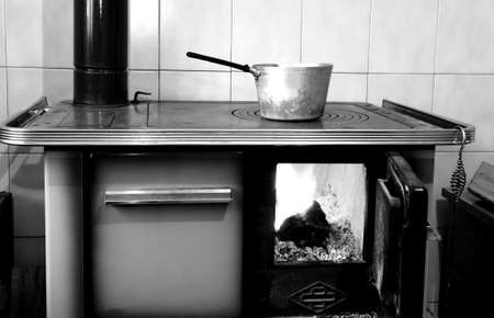 wood burner: old wood-burning stove in the kitchen of mountain home