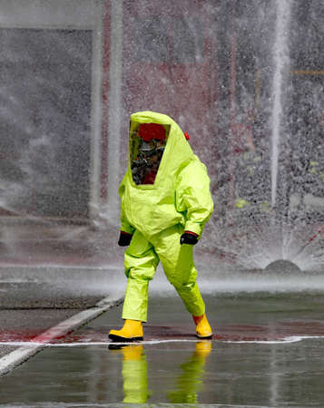 hazmat: man with yellow protective gear against biological risk Stock Photo
