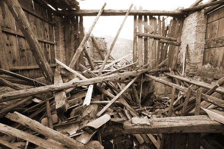 wooden planks and rubble and the ruins of the house completely destroyed by powerful earthquake Stock fotó
