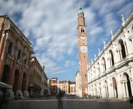Vicenza, Italy. big square of the city with the famous monument called BASILICA PALLADIANA and people on the move Editorial