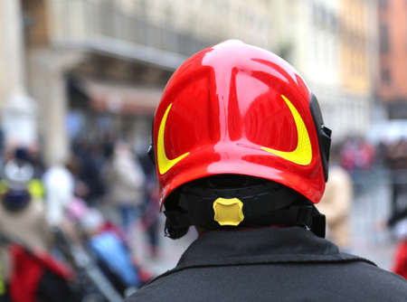 supervise: Watch fireman with red hard hat in the city
