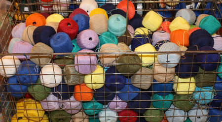 soft sell: heap of balls of very soft wool for sale Stock Photo