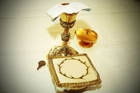 consecrated: Golden Chalice with consecrated hosts in a Christian Church during Holy Mass Stock Photo
