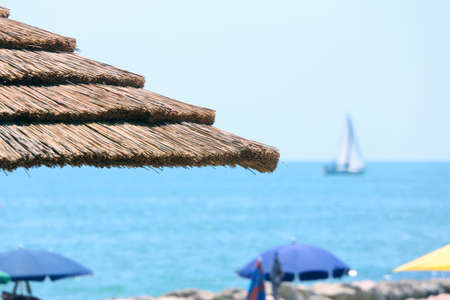 foreshore: Beach with parasols made with bamboo and straw in the luxurious resort Stock Photo