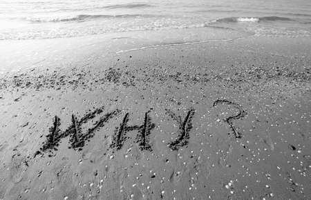 inquiring: Great inscription written on the sand of the sea with the words WHY