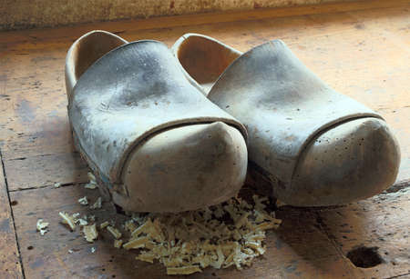 clogs: Two old Dutch style wooden clogs in the workshop of a shoemaker
