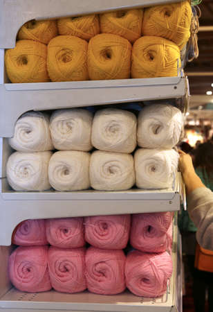 cable tangle: balls of wool for sale on the shelf in the wholesalers shop Stock Photo