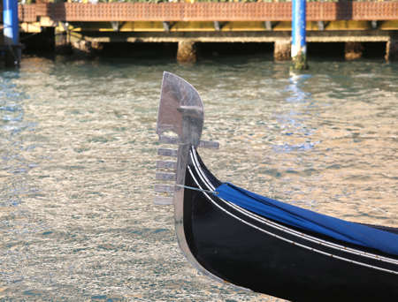 saint mark square: New Venetian gondola sailing the sea near Saint Mark Square