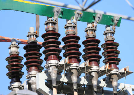 powerhouse: big copper busbar with high-voltage cables and insultators in an electric power plant