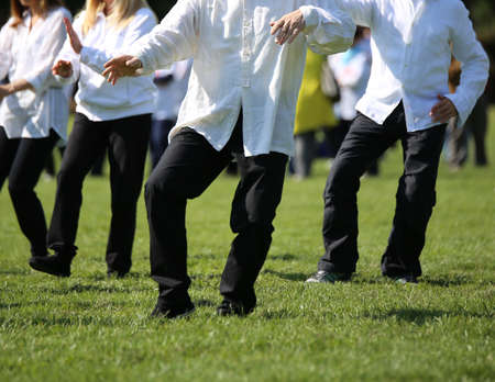 People expert martial arts Tai Chi train with movements to find the right positions in the public park