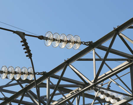 powerhouse: high lattice with electric cables in aluminum of high voltage to transport the electrical energy