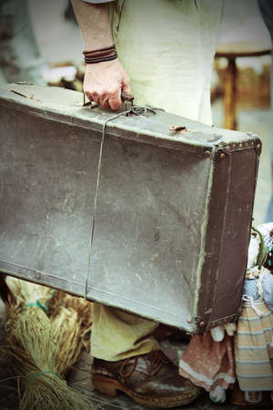 emigrant: migrant with old leather suitcase waiting to boarding