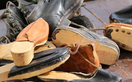 cobbler: old leather shoes of a street cobbler