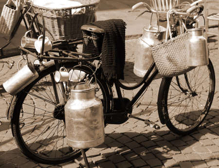 milkman: very old bicycle of milkman for transporting milk cans
