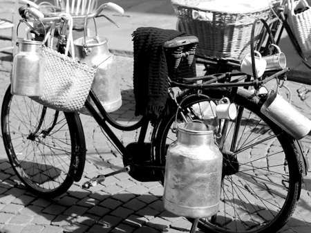 milkman: old bike of a milkman deliver milk cans in the dairy
