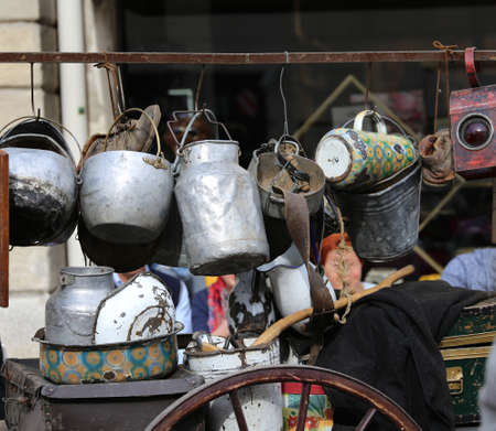 poorness: cart with many pots and pans of hawker of old iron