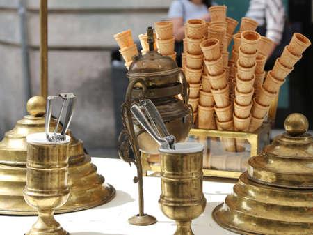 ice cream stand: sweet waffle ice cream cones in the ice cream cart in antique style Stock Photo