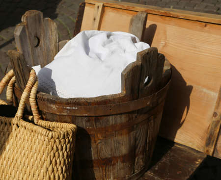 bathtub old: old wooden tub for washing clothes and doing laundry by hand Stock Photo