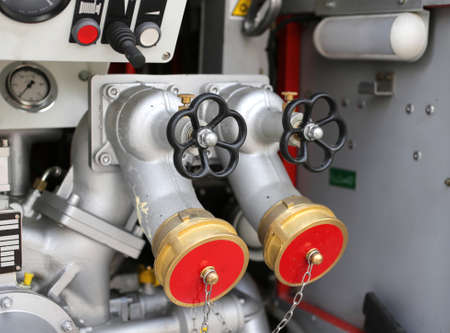 fire engine: large fire control equipment with taps and hoses of firefighters in fire engine Stock Photo