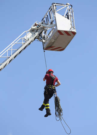 rappel: firefighters hung the rope climbing during the practical exercise in firehouse
