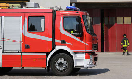 fire brigade: red fire engine truck during a fire drill in the fire brigade station Stock Photo