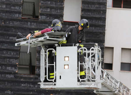 accident fire truck: firefighters in the fire truck basket during the practice of training in firehouse Stock Photo