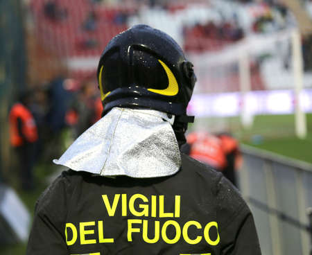 sporting event: Italian firefighter with uniform with the inscription FIREFIGHTERS do the security service in the Stadium during the sporting event