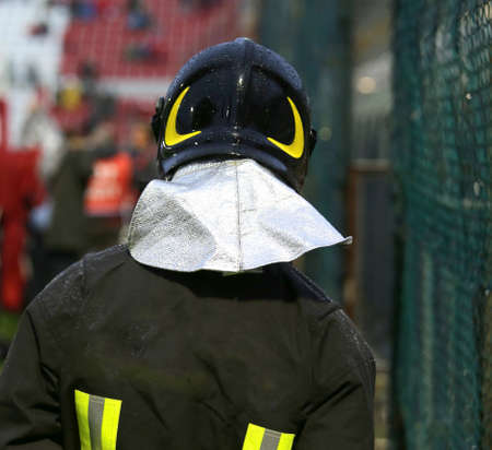 sporting event: Firefighter with riot helmet for the security service in the Stadium during the sporting event Stock Photo