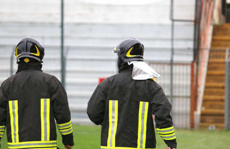 fire brigade: fire brigade with helmet for the security service in the stadium