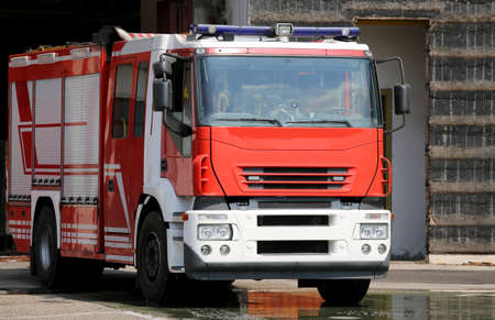 fire brigade: one fire engine truck during a fire drill in the fire brigade station