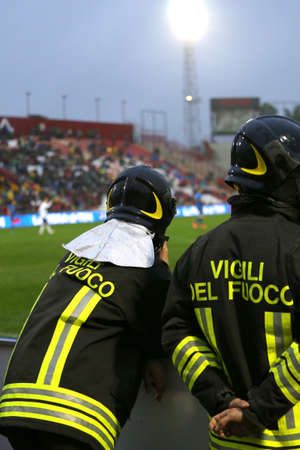 sporting event: Italian firefighters with uniform with the written FIREFIGHTERS do the security service during the sporting event