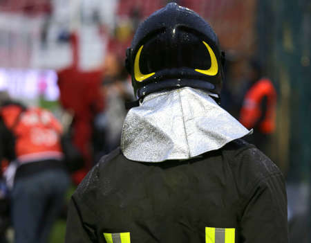 sporting event: Firefighter with riot helmet in the Stadium during the sporting event
