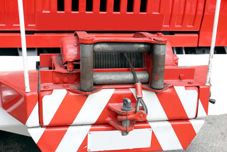 hoist: robust hoist with steel ropeinstalled on a big fire truck Stock Photo
