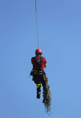caving: climber firefighter hung the rope climbing during the practical exercise