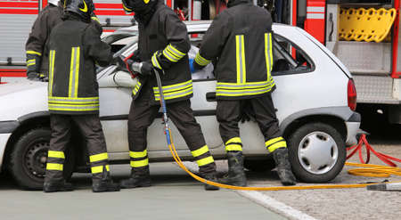 relieve: brave firefighters relieve an injured after an accident during a practice session in the fire station Stock Photo