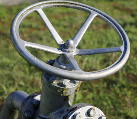 shutting: detail of big valve for shutting off the pipe with swivel maneuver to a circular shape for the plant management multiutilities company Stock Photo