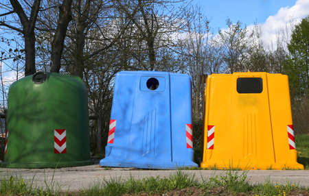 waster: three bins for waste paper collection and for the collection of used plastic and glass bottle Stock Photo