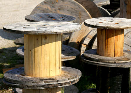 landfill: large wooden spools for the transport of electric cables in a landfill of recyclable materials