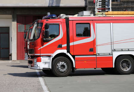 fire brigade: big fire engine truck during a fire drill in the fire brigade station