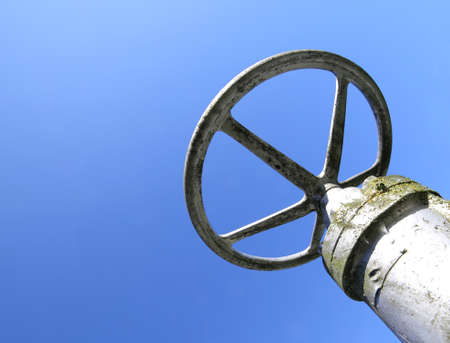 extent: big valve with a sliding part that controls the extent of the aperture of pipeline in the industrial plant Stock Photo