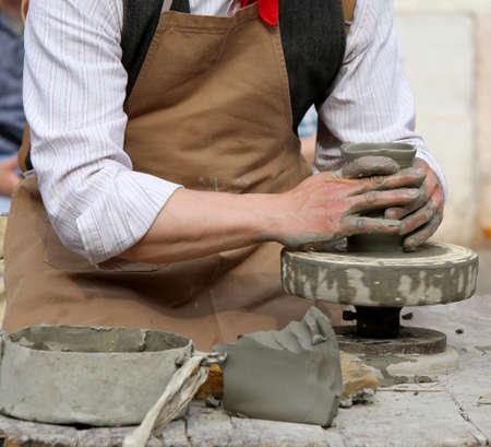 alfarero: skilled craftsman potter shaping clay to make a beautiful vase handmade